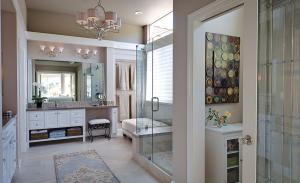 A range of porcelain, glass and mosaic tile create a sophisticated master bath design in a private residence located in